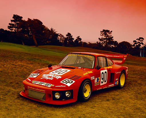 POR 27 RK0031 02 © Kimball Stock 1978 Porsche 935 RSR Red Front 3/4 View On Grass Hill