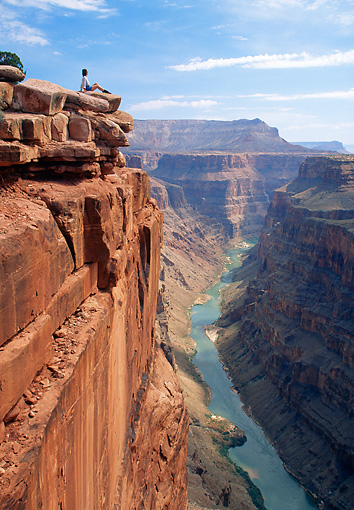 REC 01 RW0001 01 © Kimball Stock Woman Sitting On Edge Of Canyon Wall