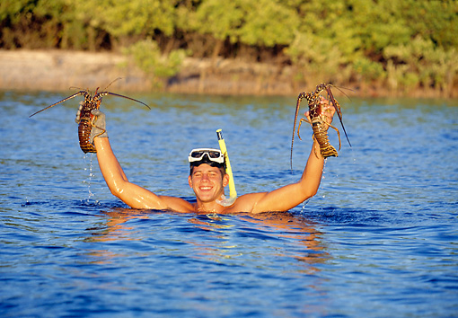REC 03 DS0003 01 © Kimball Stock Man Standing In Water Holding Up Crayfish
