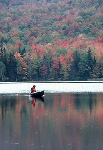 REC 03 DS0001 01 © Kimball Stock Man Paddling Canoe In Lake By Autumn Forest