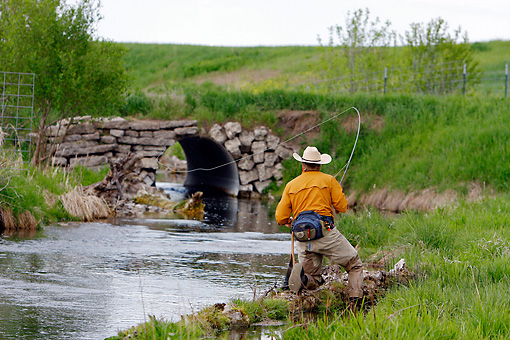 REC 04 DB0002 01 © Kimball Stock Man Standing In Stream Fishing