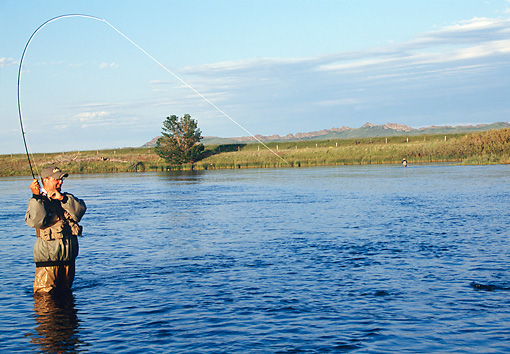 REC 04 DS0007 01 © Kimball Stock Man Standing In Lake Fishing