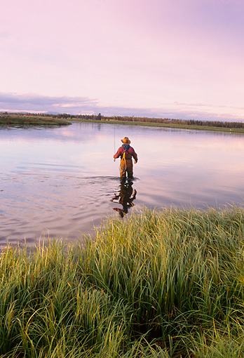 REC 04 DS0013 01 © Kimball Stock Man Standing In Lake Fishing