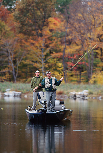 REC 04 DS0003 01 © Kimball Stock Two Men Standing On Boat Fly Fishing
