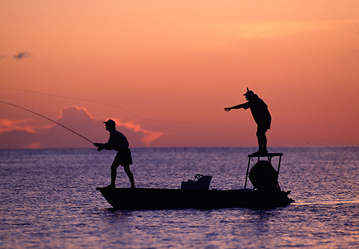 REC 04 DS0004 01 © Kimball Stock Silhouette Two Men Standing On Boat Fly Fishing