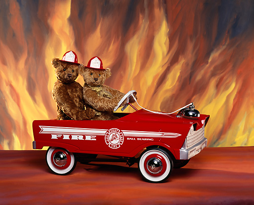 TED 01 RK0093 05 © Kimball Stock Two Teddy Bears Riding In Fire Truck Flames Roley Bears