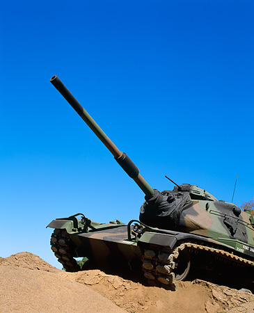 TNK 01 RK0009 01 © Kimball Stock Camouflage M-60 Tank 3/4 Front View On Dirt Hill Blue Sky