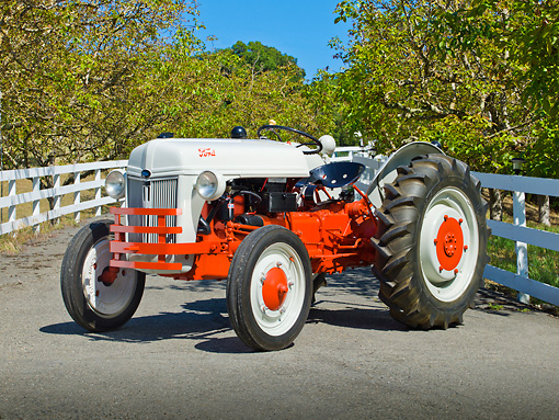 TRA 01 RK0131 01 © Kimball Stock 1939 Ford 9N Tractor White And Red 3/4 Front View On Pavement By Fence And Trees