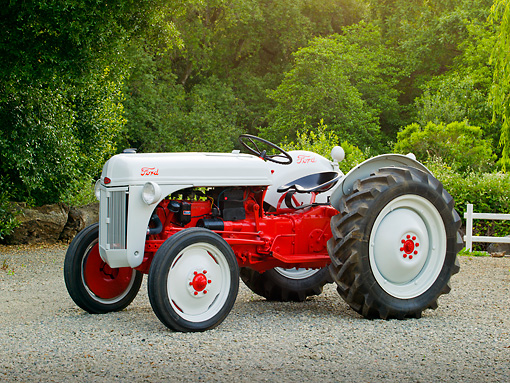 TRA 01 RK0133 01 © Kimball Stock 1948 Ford 8N Tractor White And Red 3/4 Side View On Gravel By Fence And Trees