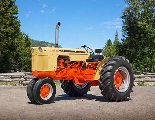 TRA 01 RK0197 01 © Kimball Stock 1962 Case 530 Tractor Flambeau Red And Desert Sunset 3/4 Side View On Gravel By Trees