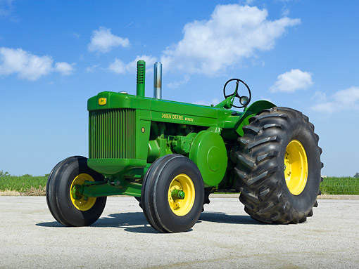TRA 01 RK0226 01 © Kimball Stock 1950 John Deere R Diesel Tractor Green And Yellow 3/4 Front View On Gravel By Farm