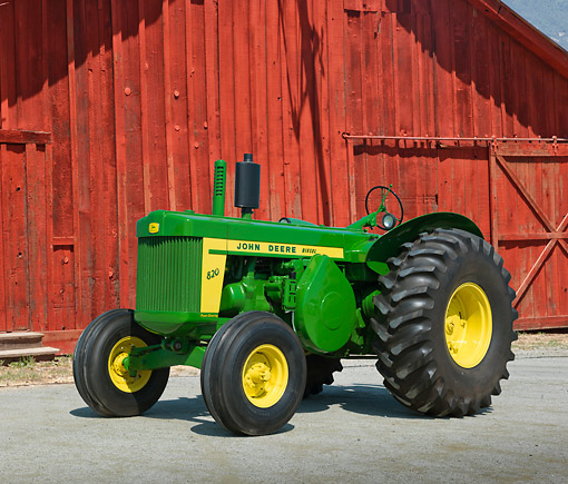TRA 01 RK0227 01 © Kimball Stock 1957 John Deere 820 Tractor Green And Yellow 3/4 Front View On Pavement By Red Barn