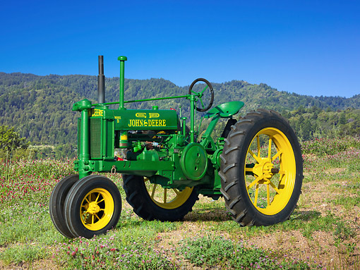 TRA 01 RK0233 01 © Kimball Stock 1936 John Deere Model B Tractor Green And Yellow 3/4 Side View On Grass By Hills