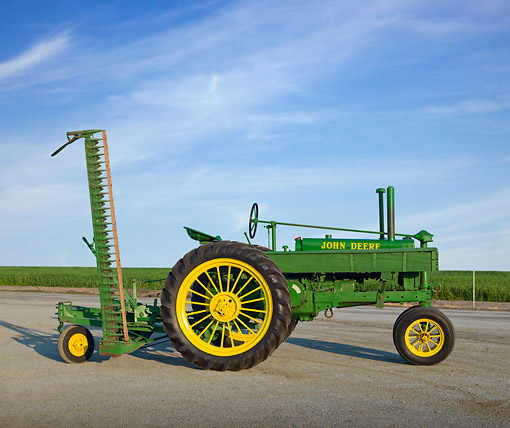 TRA 01 RK0235 01 © Kimball Stock 1936 John Deere Model B Tractor Green And Yellow Profile View On Pavement By Farm