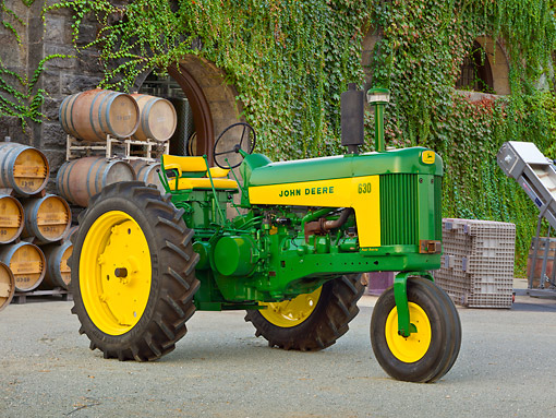 TRA 01 RK0242 01 © Kimball Stock 1959 John Deere 630 Tractor Green And Yellow 3/4 Side View On Pavement By Winery