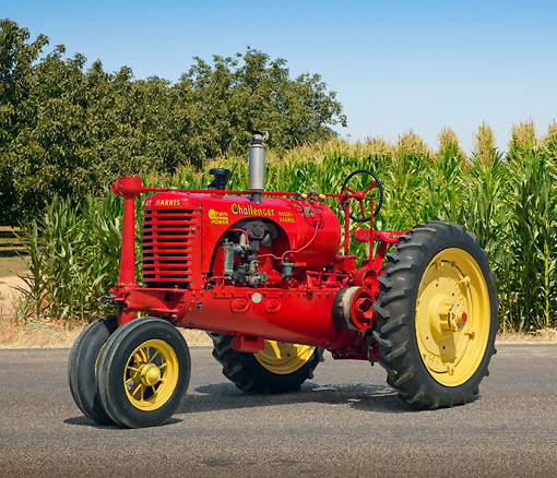TRA 01 RK0248 01 © Kimball Stock 1938 Massey-Harris Challenger Tractor Red And Yellow 3/4 Side View On Pavement By Cornfield