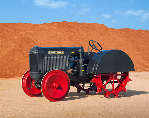 TRA 01 RK0261 01 © Kimball Stock 1929 McCormick-Deering 10-20 Tractor IH Gray 3/4 Side View On Dirt By Red Dirt Pile