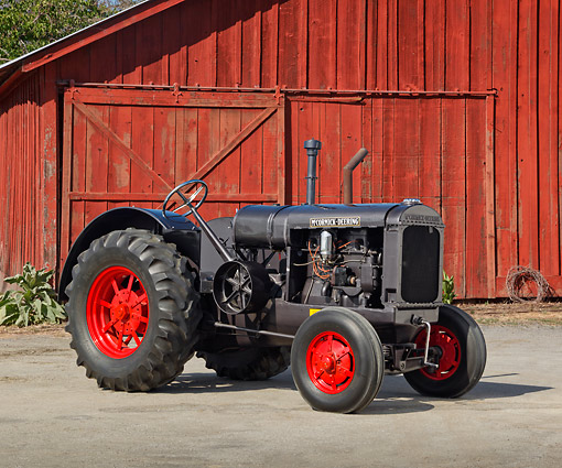 TRA 01 RK0263 01 © Kimball Stock 1929 McCormick-Deering 15-30 Tractor IH Gray 3/4 Side View On Pavement By Red Barn
