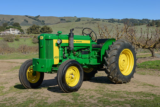 TRA 01 RK0285 01 © Kimball Stock 1954 John Deere 420 Tractor Green And Yellow 3/4 Front View On Grass