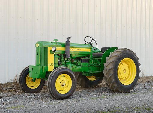 TRA 01 RK0286 01 © Kimball Stock 1954 John Deere 420 Tractor Green And Yellow 3/4 Side View On Gravel