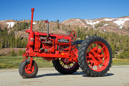 TRA 01 RK0289 01 © Kimball Stock 1936 Farmall F-12 Red 3/4 Side View On Pavement By Mountains