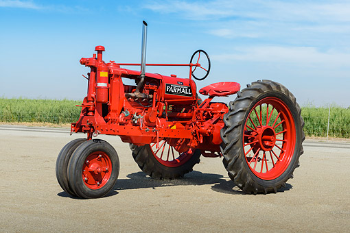 TRA 01 RK0290 01 © Kimball Stock 1938 Farmall F-14 Red 3/4 Side View On Pavement By Cornfield