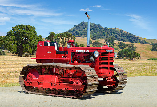 TRA 01 RK0309 01 © Kimball Stock 1950 International TD-9 Tractor Red 3/4 Side View On Pavement By Hills