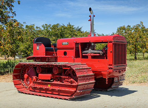 TRA 01 RK0314 01 © Kimball Stock 1935 McCormick-Deering T-40 Tractor Red 3/4 Side View On Gravel By Trees
