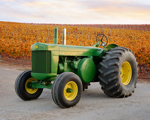 TRA 01 RK0316 01 © Kimball Stock 1951 John Deere R Tractor Green And Yellow 3/4 Front View On Gravel By Autumn Vineyard