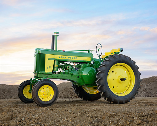 TRA 01 RK0319 01 © Kimball Stock 1957 John Deere 620 Tractor Green And Yellow 3/4 Side View On Dirt