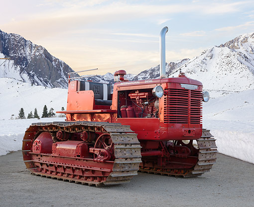 TRA 01 RK0337 01 © Kimball Stock 1950 International TD-14A Tractor Red 3/4 Front View On Gravel In Snow