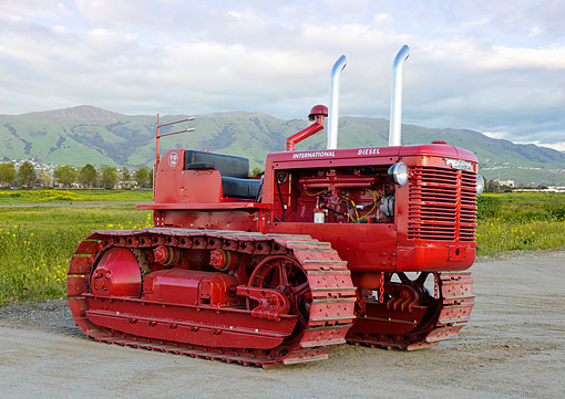 TRA 01 RK0338 01 © Kimball Stock 1950 International TD-18A Tractor Red 3/4 Front View On Gravel By Grassy Hills
