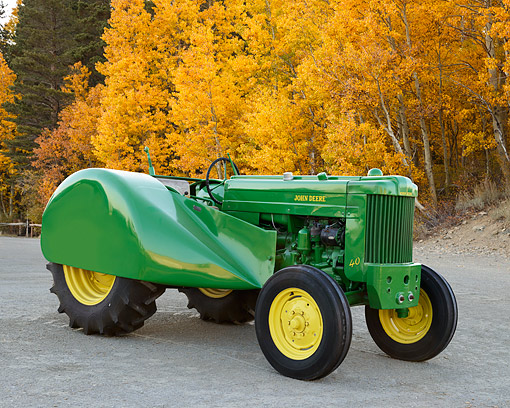 TRA 01 RK0340 01 © Kimball Stock 1954 John Deere 40 Tractor Green And Yellow 3/4 Front View On Gravel By Autumn Trees