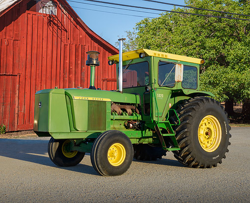 TRA 01 RK0342 01 © Kimball Stock 1970 John Deere 5020 Tractor Green And Yellow 3/4 Side View On Gravel By Red Barn