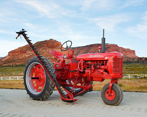 TRA 01 RK0348 01 © Kimball Stock 1951 McCormick Farmall Super C Tractor Red 3/4 Side View On Gravel By Red Rock