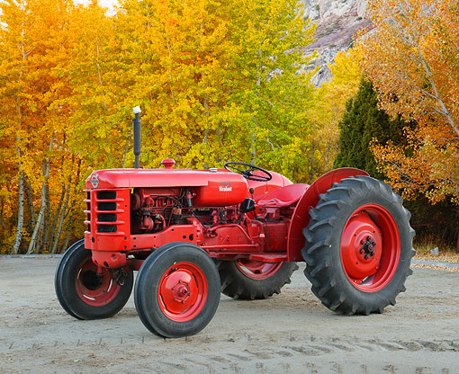 TRA 01 RK0351 01 © Kimball Stock 1957 Volvo Krabat Tractor Red 3/4 Side View On Gravel By Autumn Trees