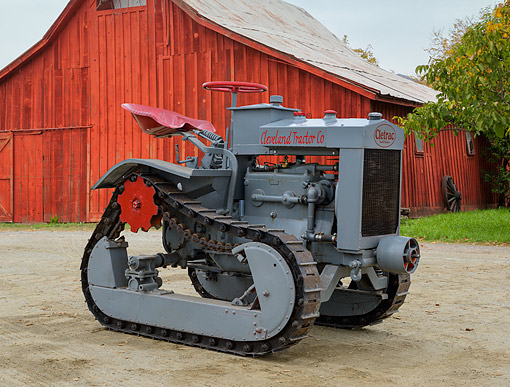 TRA 01 RK0352 01 © Kimball Stock 1920 Cletrac Model F Gray 3/4 Side View On Dirt By Barn