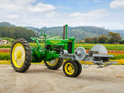 TRA 01 RK0368 01 © Kimball Stock 1937 John Deere B Tractor With Saw 3/4 Front View On Farm
