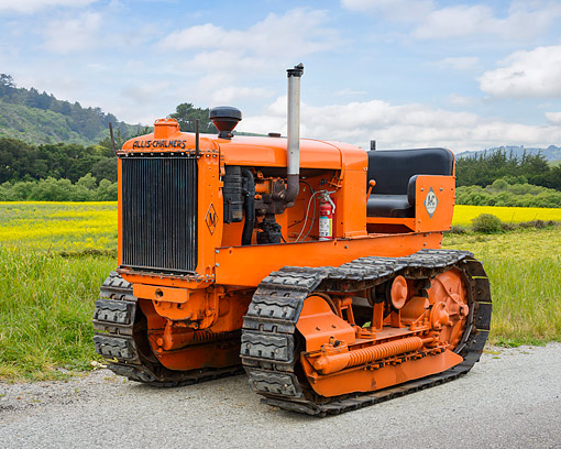 TRA 01 RK0372 01 © Kimball Stock 1940 Allis-Chalmers M Tractor 3/4 Front View In Meadow