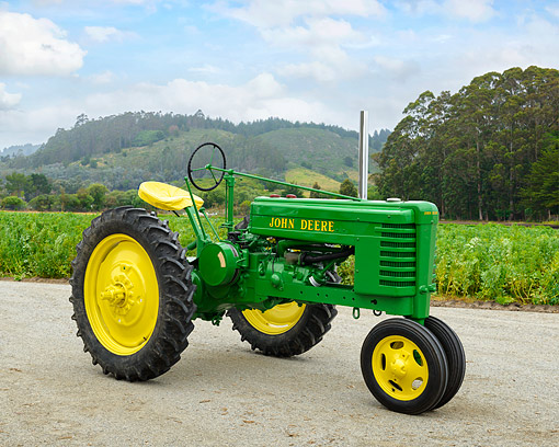 TRA 01 RK0374 01 © Kimball Stock 1941 John Deere H Tractor Green 3/4 Front View On Farm