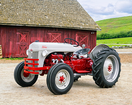 TRA 01 RK0376 01 © Kimball Stock 1942 Ford 9N Tractor 3/4 Front View By Barn