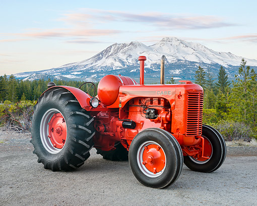 TRA 01 RK0380 01 © Kimball Stock 1947 Case LA Tractor Red 3/4 Front View By Forest And Mountains