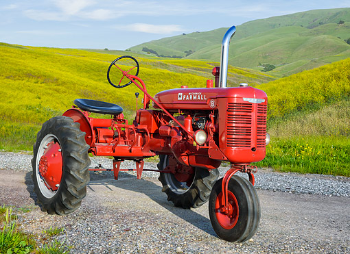 TRA 01 RK0383 01 © Kimball Stock 1948 Farmall B Tractor Red 3/4 Front View By Grassy Hills