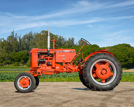 TRA 01 RK0384 01 © Kimball Stock 1949 Case VAC Tractor Orange Profile View On Farm