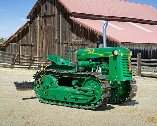 TRA 01 RK0388 01 © Kimball Stock 1951 Oliver OC3 Tractor Green 3/4 Front View By Barn