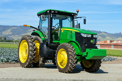 TRA 01 RK0406 01 © Kimball Stock 2012 John Deere 7215R Tractor Green 3/4 Front View On Farm