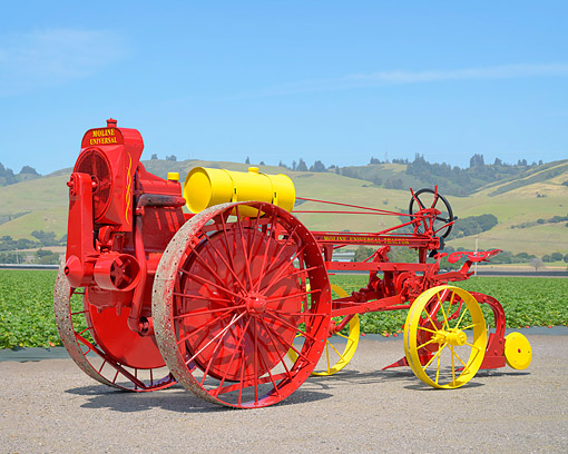 TRA 01 RK0408 01 © Kimball Stock 1919 Moline Universal Tractor Red 3/4 Front View On Farm