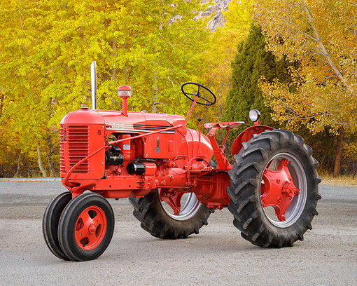 TRA 01 RK0415 01 © Kimball Stock 1941 Case V Tractor Red 3/4 Front View By Autumn Trees