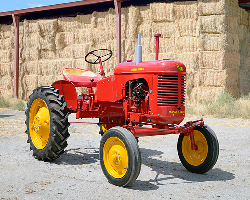 TRA 01 RK0420 01 © Kimball Stock 1948 Massey-Harris Pony Tractor Red 3/4 Front View By Hay Bales