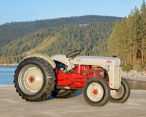 TRA 01 RK0426 01 © Kimball Stock 1951 Ford 8N Tractor Gray 3/4 Front View By Lake And Mountains